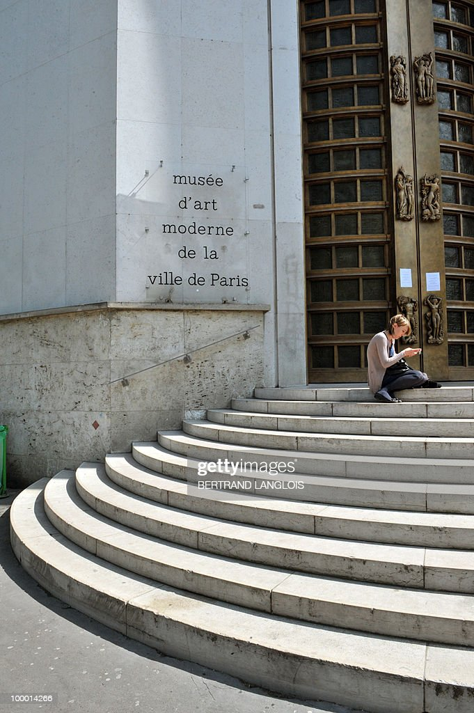 A woman sits on May 20, 2010 on the stairs at the entrance of the Paris' Musee d'Art Moderne (Paris modern art museum), which is closed after five works including paintings by modern masters Henri Matisse and Pablo Picasso have been stolen. The canvases, worth a total of 500 million euros (635 million dollars), were discovered missing from the city-run Musee d'Art Moderne when it opened its doors.