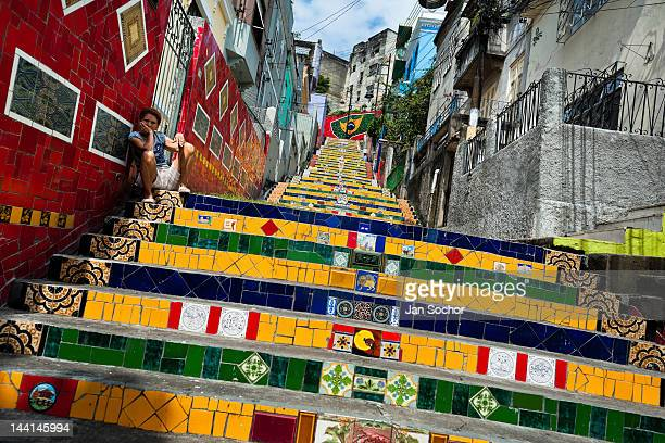 A woman sits on Selaron's Stairs a mosaic staircase made of colorful tiles on February 13 2012 in Rio de Janeiro Brazil World famous staircase mostly...