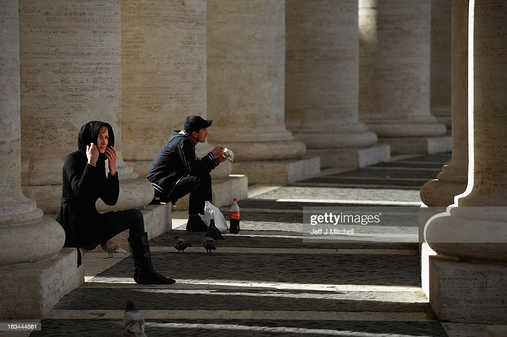A woman sits on the Colonnade in St Peter's Square on March 10, 2013 in Vatican City, Vatican. Cardinals are set to enter the conclave to elect a successor to Pope Benedict XVI after he became the first pope in 600 years to resign from the role. The conclave is scheduled to start on March 12 inside the Sistine Chapel and will be attended by 115 cardinals as they vote to select the 266th Pope of the Catholic Church.