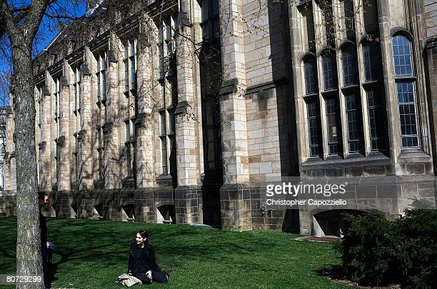 A woman sits on the grass on the campus of Yale University April 15 2008 in New Haven Connecticut New Haven boasts many educational and cultural...