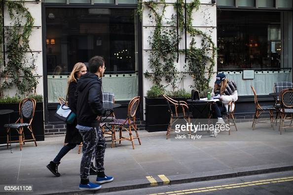 A woman sits outside a restaurant in Marylebone on February 16 2017 in London England The Association for Licensed Multiple Retailers have written to...