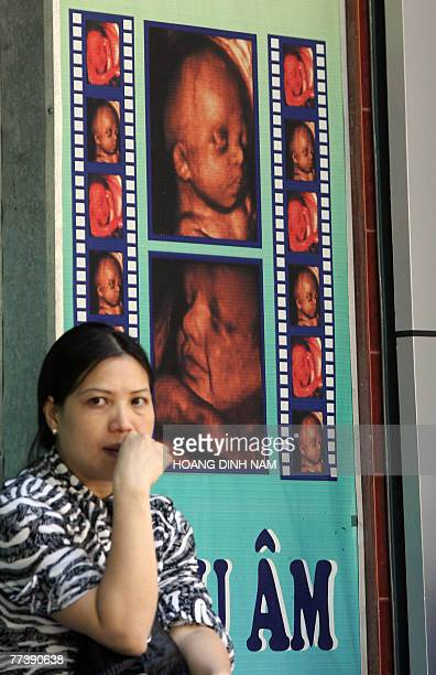 A woman sits waiting for her turn for a feotus ultrasound imaging service at a private medical practise in Hanoi 18 October 2007 Many Vietnamese...