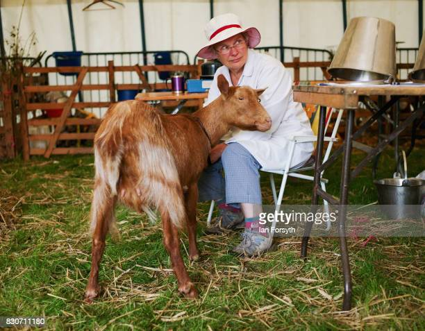 A woman sits with her goat during the 194th Sedgefield Show on August 12 2017 in Sedgefield England The annual show is held on the second Saturday...