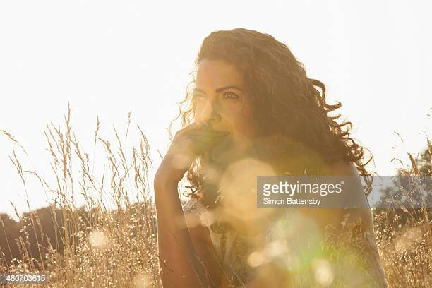 Woman sitting amongst wild flowers
