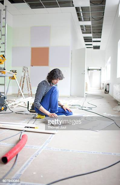 Woman sitting and working with laptop