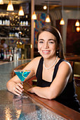 Woman sitting at a bar with a martini