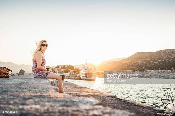 Woman sitting at coast at Pythagoreio, Samos, Greece