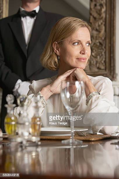 Woman sitting at dinner table