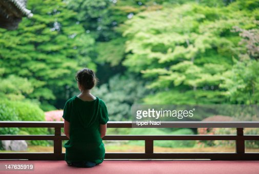 Woman sitting at garden