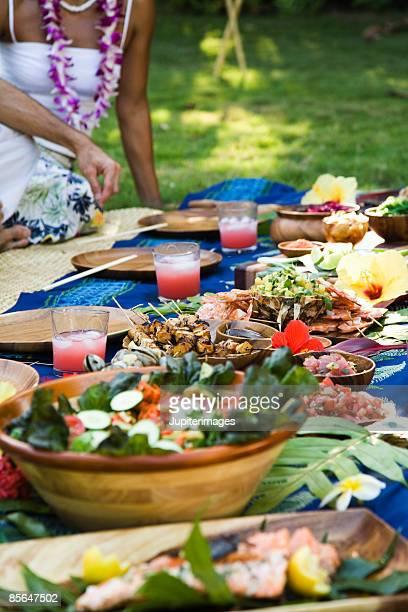 Woman sitting at Hawaiian picnic