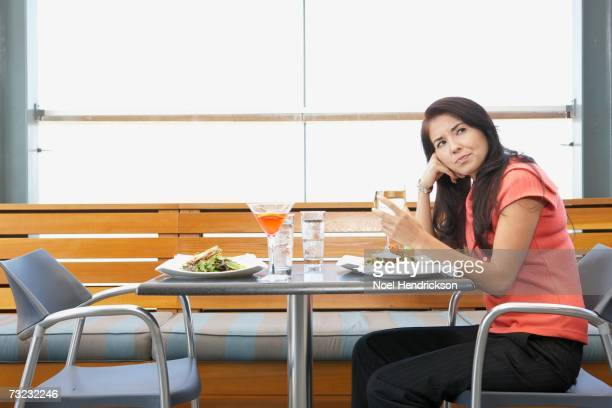 Woman sitting at table in restaurant