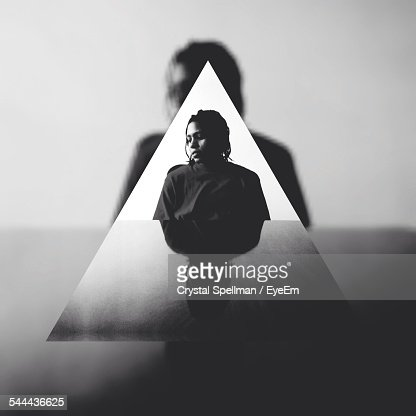 Woman Sitting At Table Seen Through Triangle Shape Glass