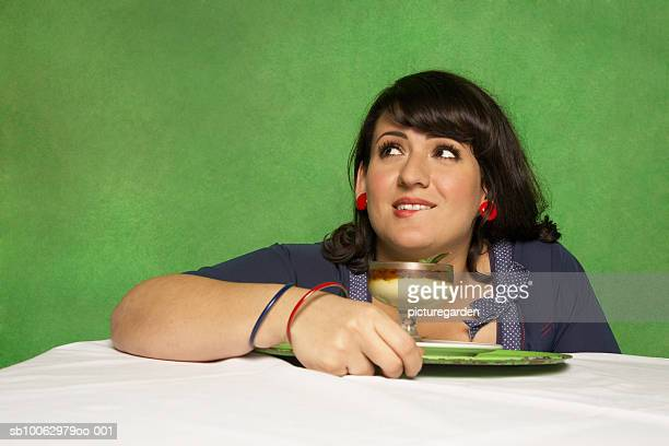Woman sitting at table with desert