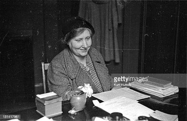 A woman sitting at the desk of an adviser at the Citizens' Advice Bureau at Poplar east London She sought advice about a wartime problem how have her...