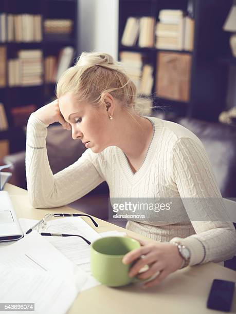woman sitting at the table and working at home