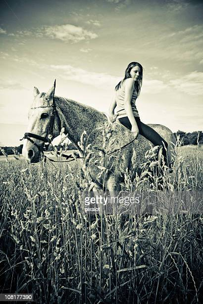 Woman Sitting Backwards on Horse