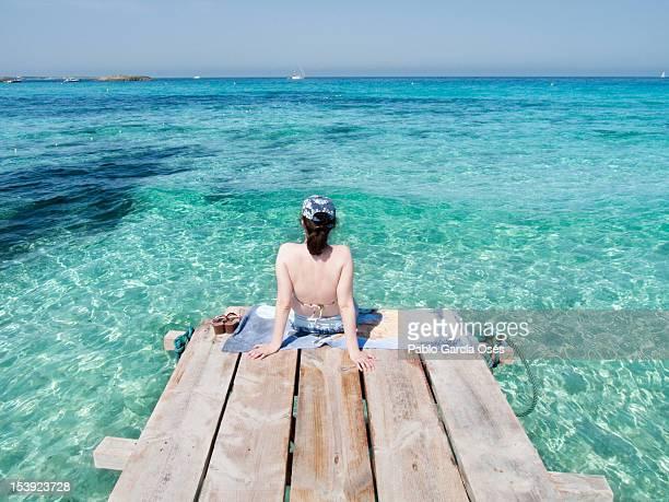 Woman sitting beach side
