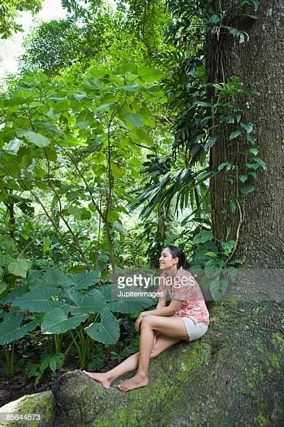 Woman sitting beneath tree