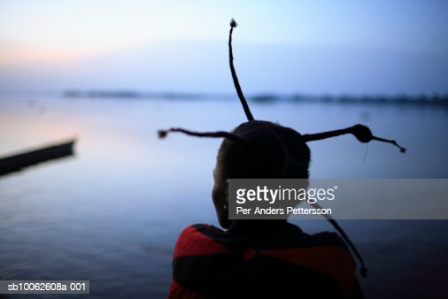 Woman sitting by Congo river, close-up : Stock Photo