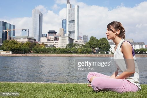 Woman Sitting by Riverbank : Stock Photo