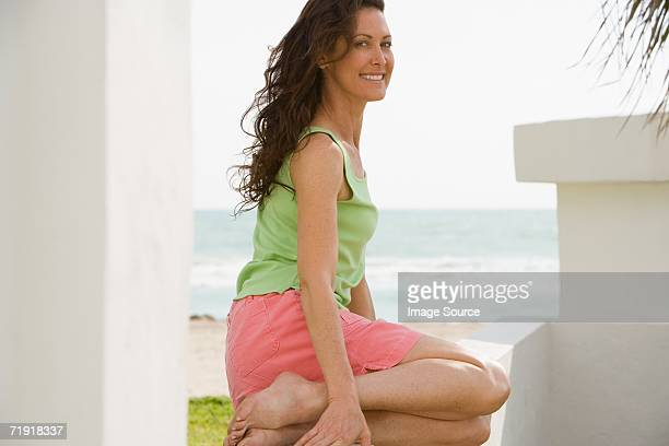 Woman sitting by the beach