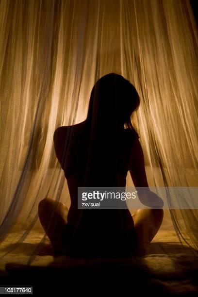 Woman Sitting Cross-legged Before Bedtime