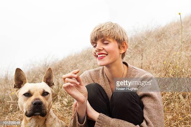 woman sitting happily dog