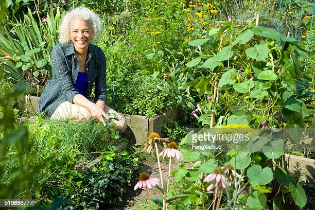 Woman sitting in a community garden