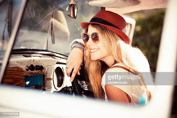 Woman Sitting In a Vintage Car