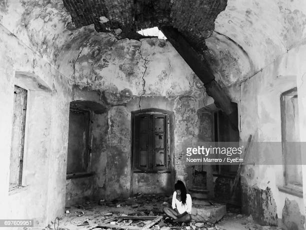 Woman Sitting In Abandoned House