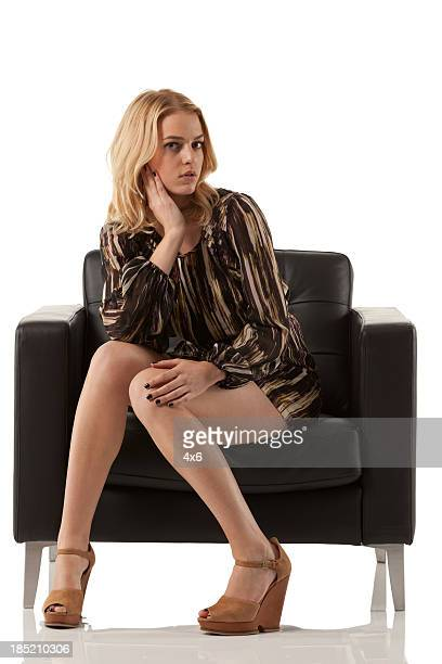 Woman sitting in armchair stock photos and pictures for Sitting in armchair