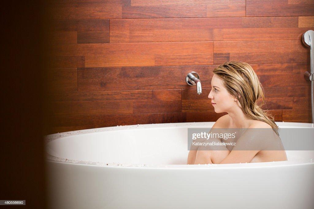 Woman sitting in bathtub : Stock Photo