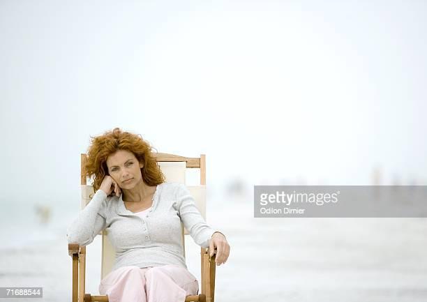 Woman sitting in beach chair