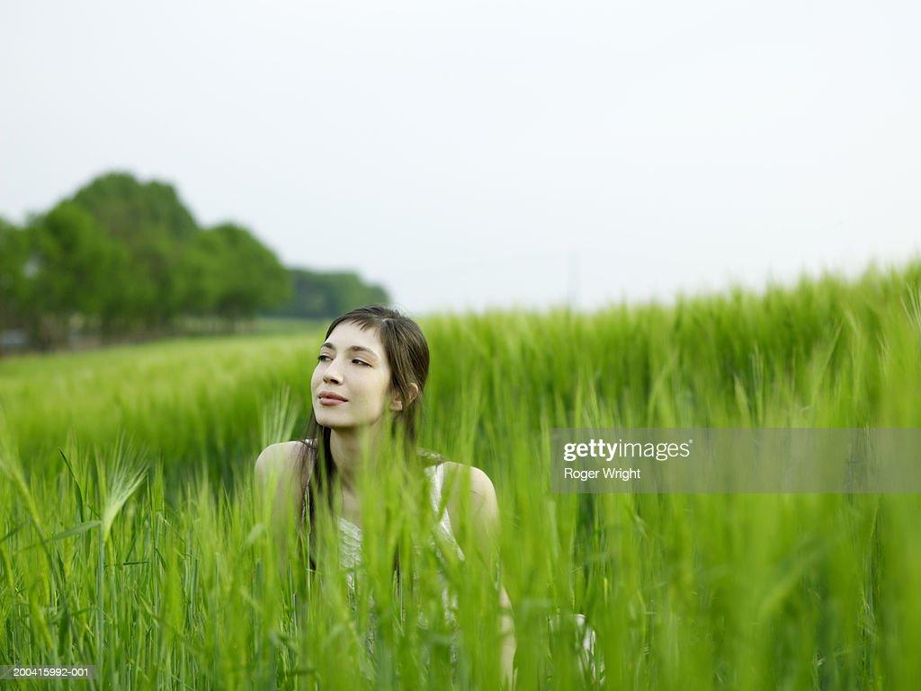 Woman sitting in beetroot field