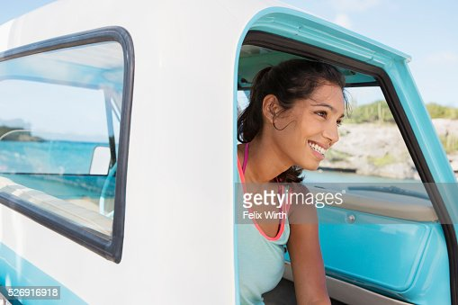 Woman sitting in car and smiling : Stock Photo