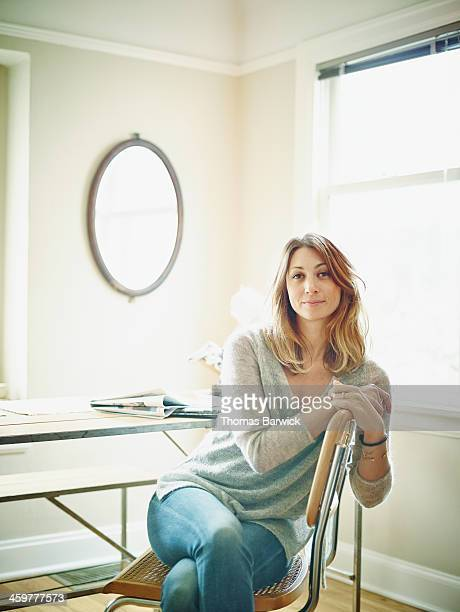 Woman sitting in chair in home
