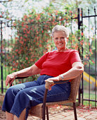 Woman sitting in chair outdoors
