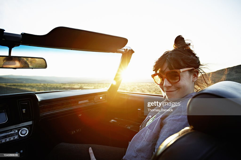 Woman sitting in front seat of convertible : Stock Photo