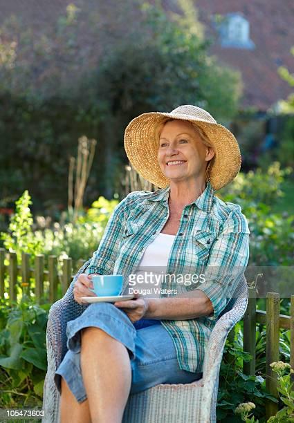 Woman sitting in garden.