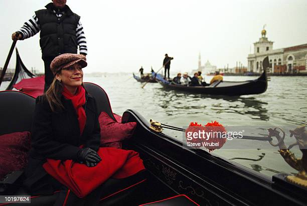 Woman sitting in gondola, Venice, Italy