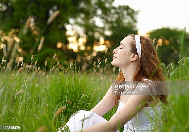 Woman sitting in grasses.