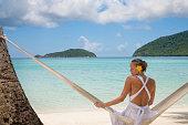 woman sitting in hammock at a beach in St.John, USVI