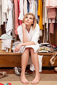 Woman sitting in her closet