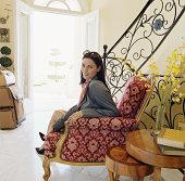 Woman sitting in hotel lobby, portrait