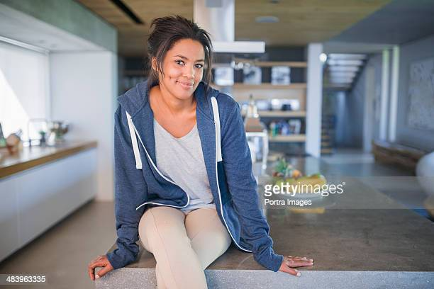 Woman sitting in kitchen