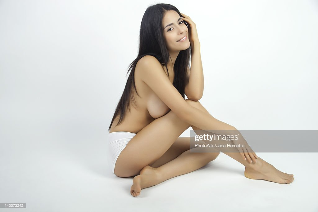 Woman sitting in underwear, full length portrait : ストックフォト