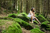 Woman sitting in woods