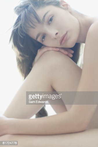 Woman sitting looking at camera
