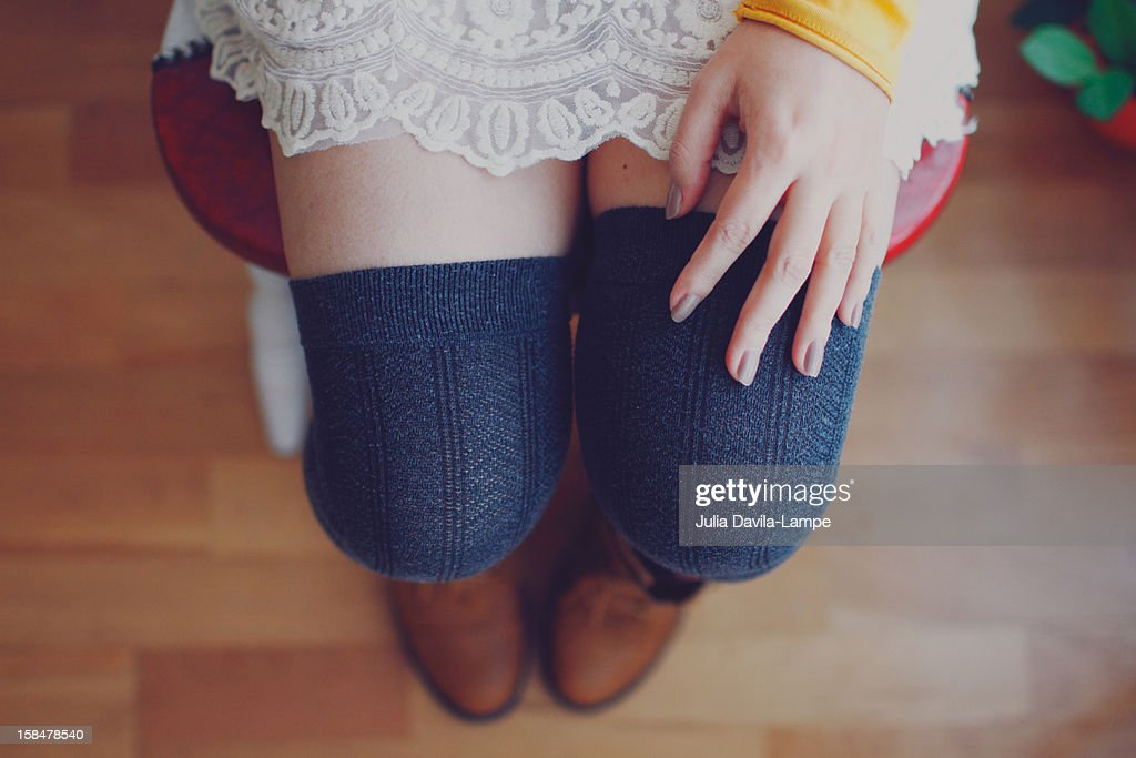 Woman sitting on a chair : Stock Photo