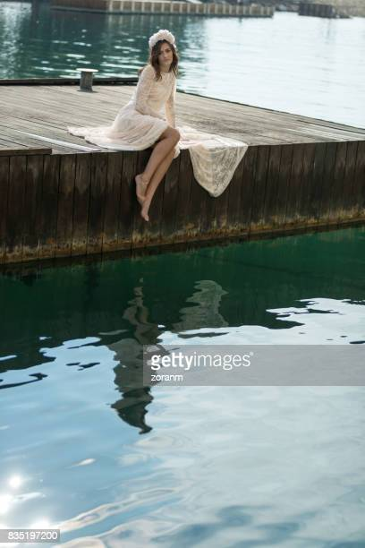 Woman sitting on a jetty